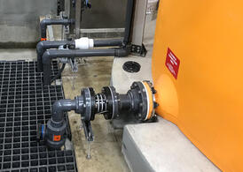 Orange IMFO Tank with Flexible connection Installed 2